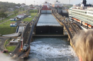 At the entrance to the Gatun Locks.  Water is emptying from the first lock after it had lifted the container ship in front of us.
